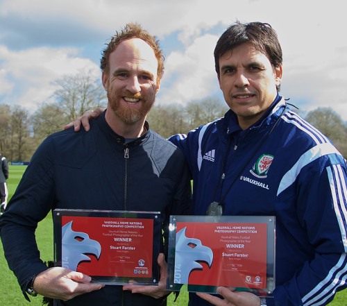 Stu Forster, left, receives his Vauxhall Home Nations phpotgrapher of the year award from Wales manager Chris Coleman