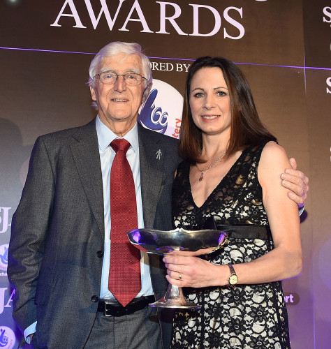 The SJA's 2014 Sportswoman of the Year, Jo Pavey, receives her trophy from Sir Michael Parkinson, the Association's President for the last 10 years