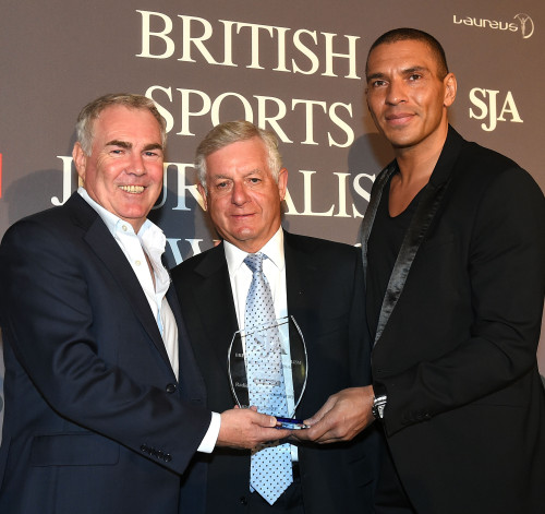 Mark Saggers (left) and Stan Collymore collect the Radio Sport Documentary award for TalkSport's from Sir Nick Lloyd (centre)
