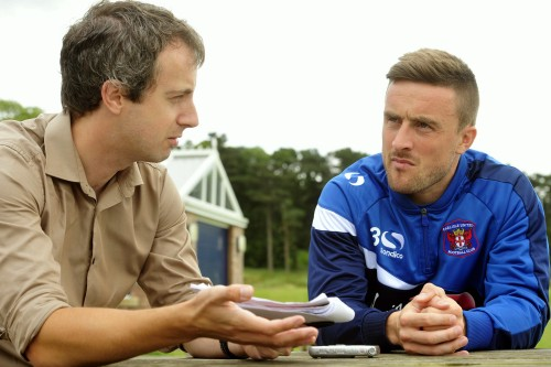 Keeping good relations with the local club can be a tightrope, says Jon Colman, seen here interviewing Carlisle's Matty Robson in pre-season