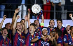 Barcelona celebrate their latest European Cup success - with Qatari logos prominent