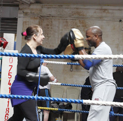 Duke McKenzie hard at work coaching in his south London gym. Photo by James Balston