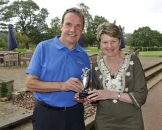 Gerry Cox receives his trophy from Gill Sheldon