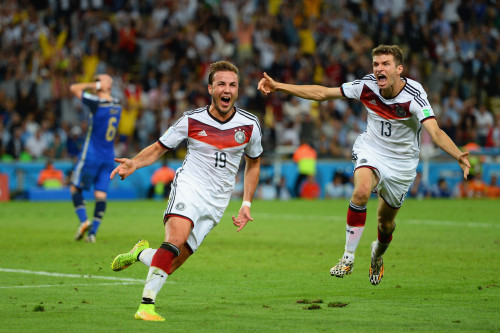 Mario Goetze celebrates Germany's first goal with Thomas Mueller in last summer's World Cup final