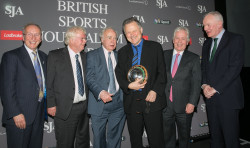 The BBC's former football correspondent, Mike Ingham, was a delighted winner of the SJA Doug Gardner Award for services to sports journalism. He received the trophy from a guard of honour