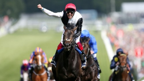 Derby delight: Frankie Dettori acclaims the convincing Epsom win for Golden Horn