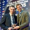 Mark Ogden, left, receives his 2013 SJA Scoop prize from Tony Adams
