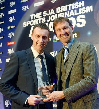 Mark Ogden, left, receives his 2013 SJA Scoop prize from Tony Adams