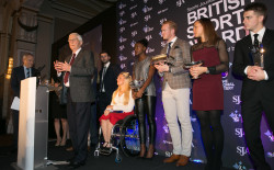 Flanked by the day's sporting winners, Sir Michael Parkinson accepts his Doug Gardner Award for services to the SJA