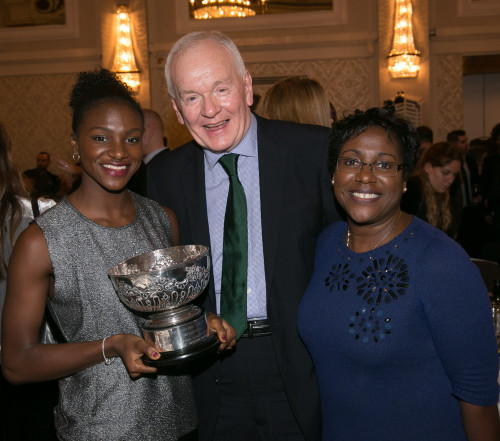Dina Asher-Smith and her mum, Julie, right, celebrate with SJA President Patrick Collins