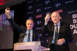 Patrick Collins, right, and compere Jim Rosenthal raise their glasses to Hugh McIlvanney on Monday night, alon with 450 other friends and colleagues
