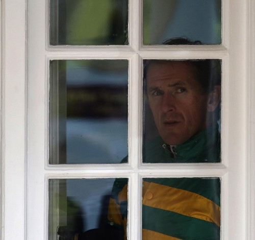 Ever vigilent, Alan Crowhurst captured this shot of champion jockey AP McCoy looking wistful from the weighing room on the day he retired from the saddle at Sandown in April