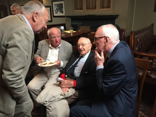 Sydney Hulls, second right, shares some membories with old friends and colleagues Jon Ryan (standing), John Jackson and (right) Patrick Collins, the SJA President