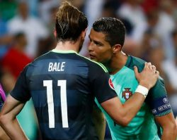 Humility: Christiano Ronaldo consoles Gareth Bale at the end of the Euro semi-final