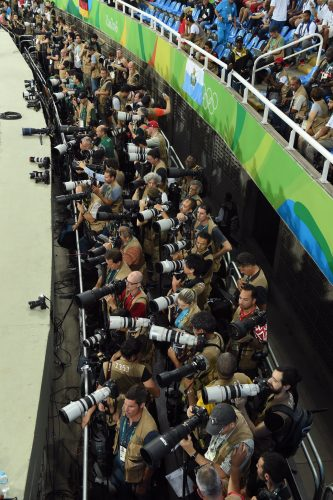 The packed photography pen in the Olympic Stadium ahead of the men's 100 metres final