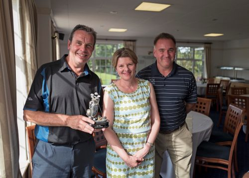 Gerry Cox, with the Phil Sheldon Trophy, presented by Gill Sheldon with Nick Cherrie, the Golf Day organiser. Photo: Patrick Eagar