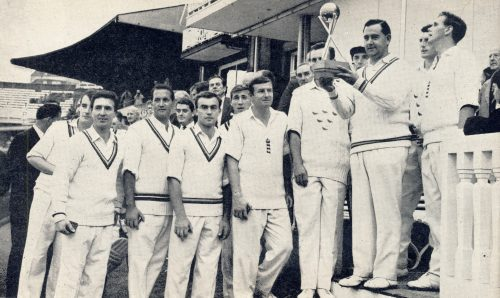 A slightly embarrassed-looking Colin Cowdrey holds aloft the Cricket World Cup at Lord's surrounded by team mates including Basil D'Oliveira, John Edrich, Fred Titmus, John Snow and, slightly obscured wearing his Sussex sweater, Ted Dexter