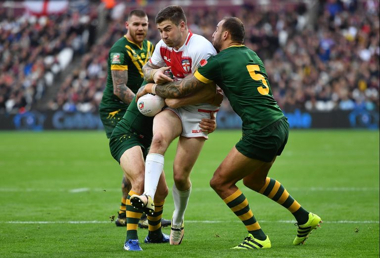 LONDON, ENGLAND - NOVEMBER 13:  Mark Percival of England loses the ball in the tackle from Blake Ferguson of Australia during the Four Nations match between the England and Australian Kangaroos at Olympic Stadium on November 13, 2016 in London, United Kingdom.  (Photo by Mike Hewitt/Getty Images)