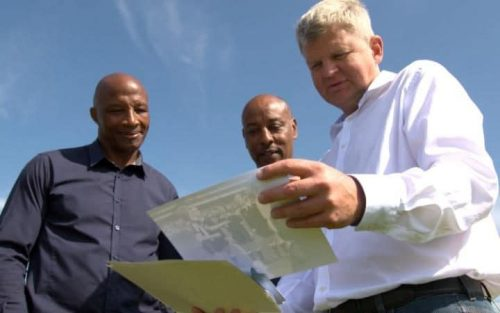 Adrian Chiles with Cyrille Regis and in the BBC's Whites v Blacks